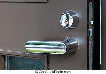 open iron brown door