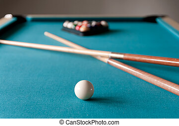 two cue Billiards lie on the table
