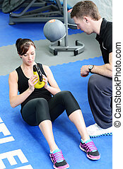 Kettle bell weight exercise - Young woman working out with...