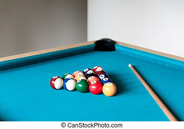 cue and balls are on the table for billiard