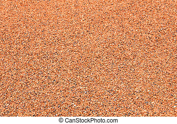 background of red gravel