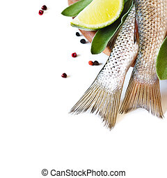 Fresh fish. - Fresh fish with spices and herbs on a kitchen...