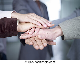 hands together - business people putting hands together to...