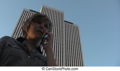 Business Woman on phone in front of building