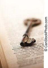 "key to success - key pointing at the word ""success\"" on a..."