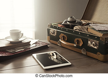 Vintage travel equipment on table - Travelers suitcase with...