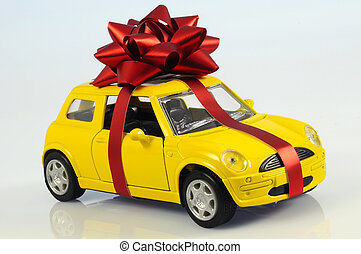 car with staple gift on neutral background