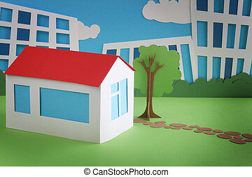 Paper cottage over city background real estate concept