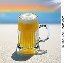 glass of beer 3 - glass of blond beer on beach background