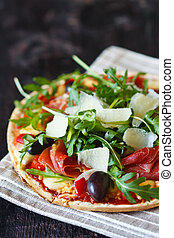 Fresh pizza - Fresh pizza with ham,olives, arugula and...