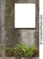 blank, white canvas frames are hanging on old concrete wall.
