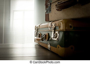 Travelling with a vintage suitcase - Pile of old suitcases...