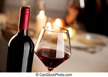 Wine tasting at restaurant - Bottle and glass of red wine...