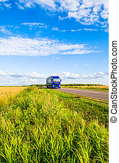 Freight wagon - truck driving on country road