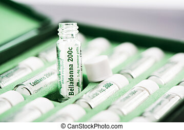 Homeopathic Medicine - Closeup of open bottles with...
