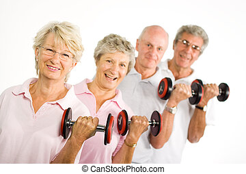 Mature older people lifting weights - Group of older mature...