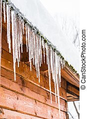 house roof icicles - roof of the house with snow and icicles...