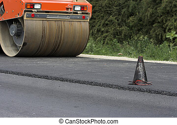 Road construction - Traffic cone and road roller