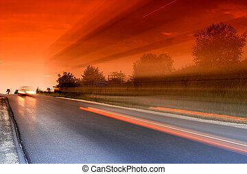 road - light-tracks over the highway by night