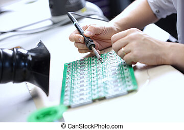 Electronic component assembly - Technician assembling...