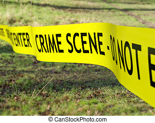 Crime Scene Cordon - Crime scene tape being used to protect...