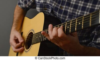 Man playing acoustic guitar, unplugged performance