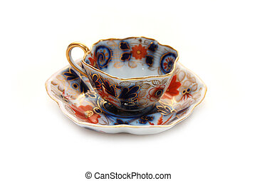 Old teacup with a saucer - Old cup with a saucer isolated...