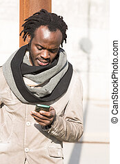 Young man using his phone - Young student using her phone to...