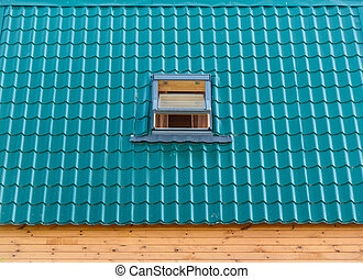roof window - green tile roof house with a built-in window