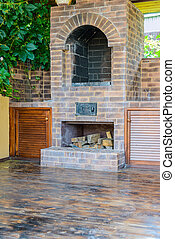oven grill - BBQ oven made ??of stone in the courtyard of...