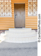 porch with white oval steps