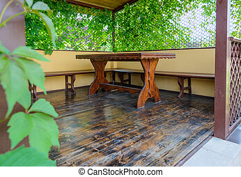 table on the veranda - wooden table on the veranda under the...