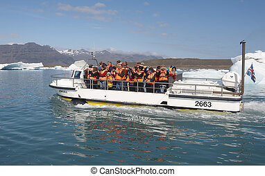 Tourists excursion on an amphibious vehicle on Jokulsarlon...