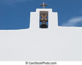Bell and cross in Sant Francesc church Formentera Spain -...