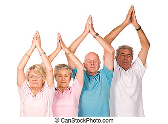 Group of mature people doing yoga - Group of older mature...