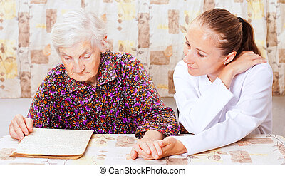 Elderly woman with the young smileing doctor - Elderly woman...