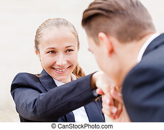 Happy young business people - Young businessman greet polite...
