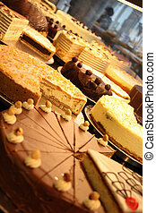 a lot of cakes in a patisserie