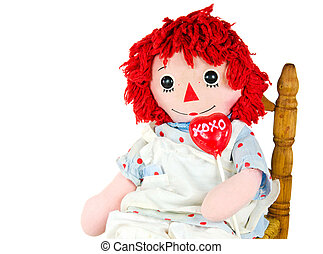 old rag doll with heart lollipop - Old rag doll in rocking...