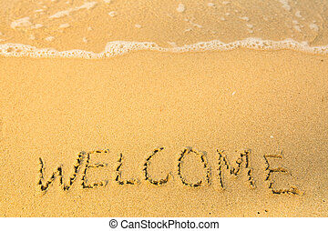 Welcome, written in sand on beach texture, soft wave of the sea.