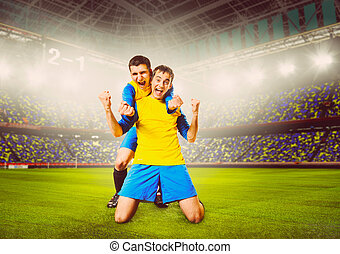 soccer players - soccer or football players are celebrating...
