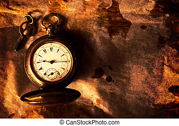 Golden pocket watch on the old paper with blank space on...