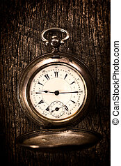 Pocket watch - Old pocket watch on the wooden...