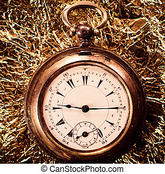 Old pocket watch on the abstract background.Selective focus...