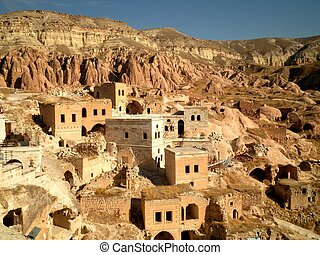 Cave Houses in Cappadocia - Scenic view of cave houses in...