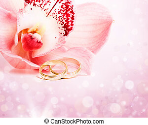 Pink orchid and wedding rings