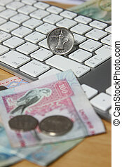 online transaction concept - one dirham on top of keyboard