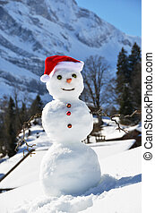 Snowman against Alpine panorama