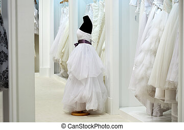 The range of wedding dresses on hangers and on a mannequin...