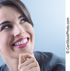 Friendly woman smiling - Attractive young woman smiling and...